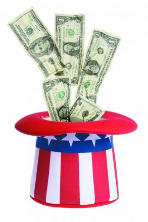 Money going into an Uncle Sam hat