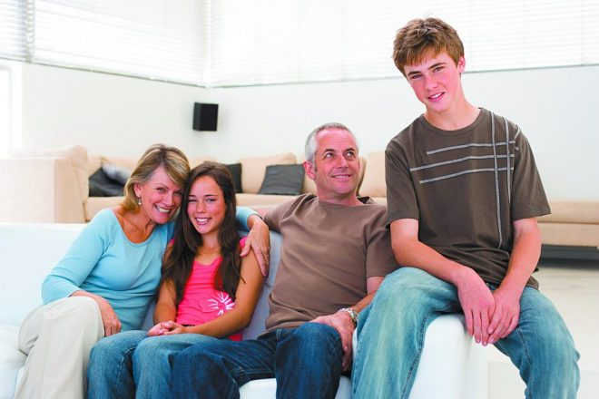 Happy family sitting together and relaxing