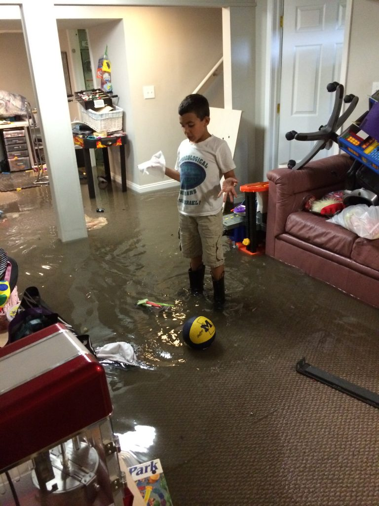 spencer cherrin of huntington woods stands in his flooded basement