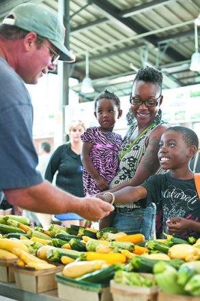 La'Tice Ford and her children use Double-Up Food Bucks tokens to buy fresh produce from a Michigan farmer.