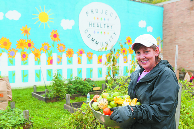 Karen Rubenfire brings in the harvest at the Project Healthy Community garden this fall.