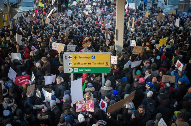 Demonstrators at JFK airport in New York protesting Donald Trump's executive order banning immigrants from certain (JTA.org)