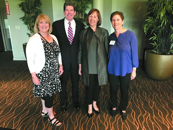 Event co-chairs Cheri Victor of Farmington Hills, left, and Nancy Finkel of Bloomfield Hills, right, flank speakers Brian Dickerson and Laura Berman