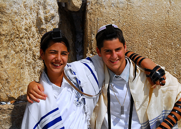 "A 12-year-old orphan from the IDF Widows and Orphans organization (left) at the Aliyah l'Torah in Israel of his ""twin"" from Germany"