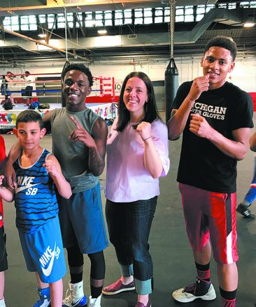 Downtown Boxing Gym Executive Director Jessica Hauser poses with a few students