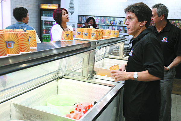 Mitch Albom works at the counter of the Detroit Water Ice Factory.