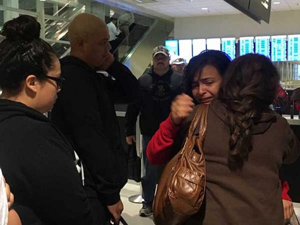 Maria Garcia Juarez, 23, of Detroit, hugs her mother-in-law, Marisela Lopez, after being told her appeal to remain in the United States was denied. (L-R) Her sister, Jocelyne Garcia, husband Erick Orozco, and an immigration official look on