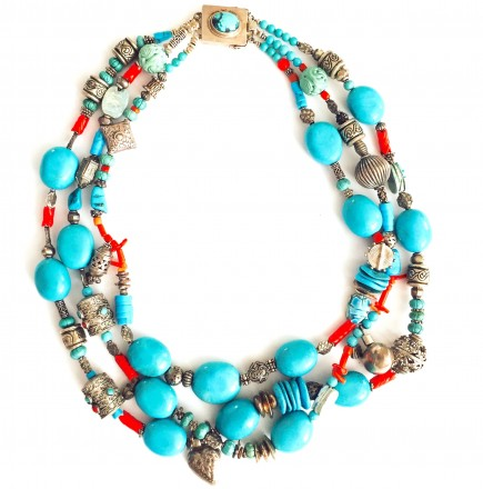 A turquoise and coral necklace by Barbara Goldberg.