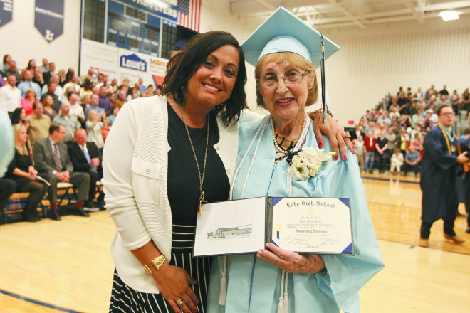 Eighth-grade English teacher Nikki Bazzoli stands with Paula Marks-Bolton who received her honorary diploma from Lake  High School in Millbury, Ohio.