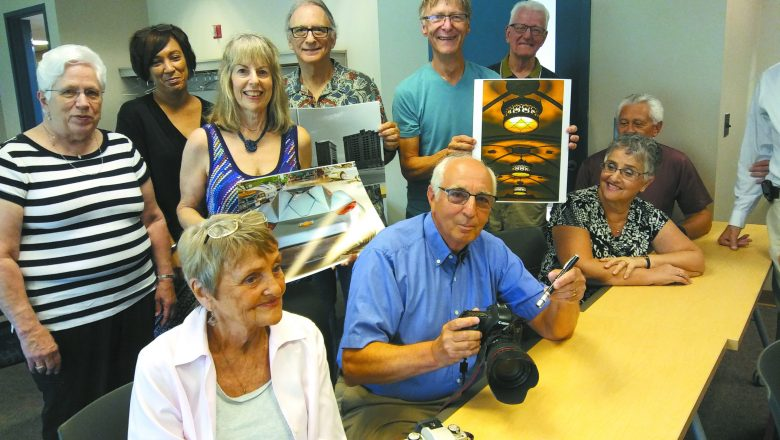 """Photography instructor Arnold """"Arnie"""" Collens shows SOAR students how a camera works"""