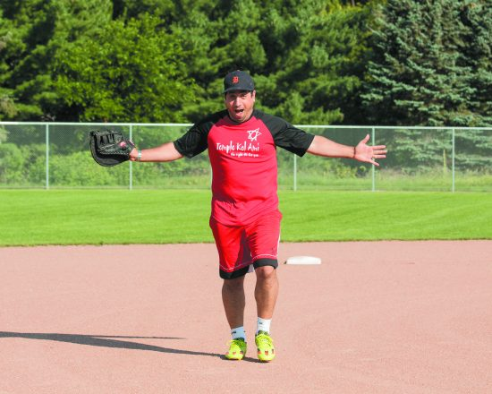 Rabbi Brent Gutmann from Temple Kol Ami has some fun on the softball diamond
