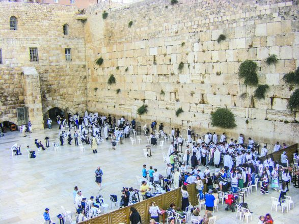 Jerusalem, Israel - March 27, 2008: Jewish worshipers gather for a Bar Mitzvah ritual at the Western wall in Jerusalem.