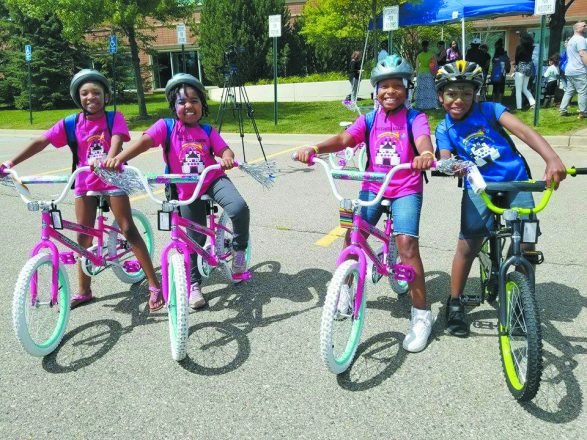 Four summer readers show off their new wheels.