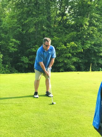 Howard Genser is a picture of concentration during the B'nai B'rith golf league competition.