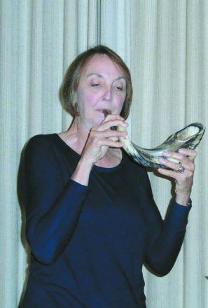 Valerie Overholt blows shofar at Workmen's Circle/Arbeter Ring.