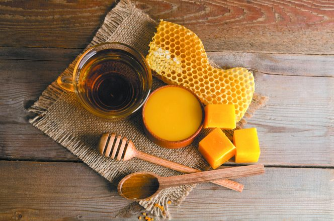 Still life from cup of tea, honey, wax and honeycombs
