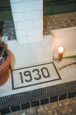 The original tiles in the bath were restored. A new, outdoor patio was added. Joe Nagle of Detroit enjoys the pool.