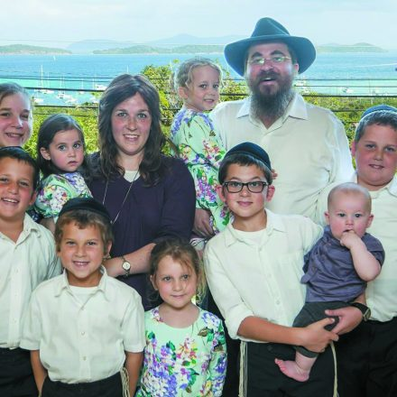 Henya and Asher Federman and their nine children; Henya and the children are now in Detroit, while Asher remained in St. Thomas to help with relief efforts.
