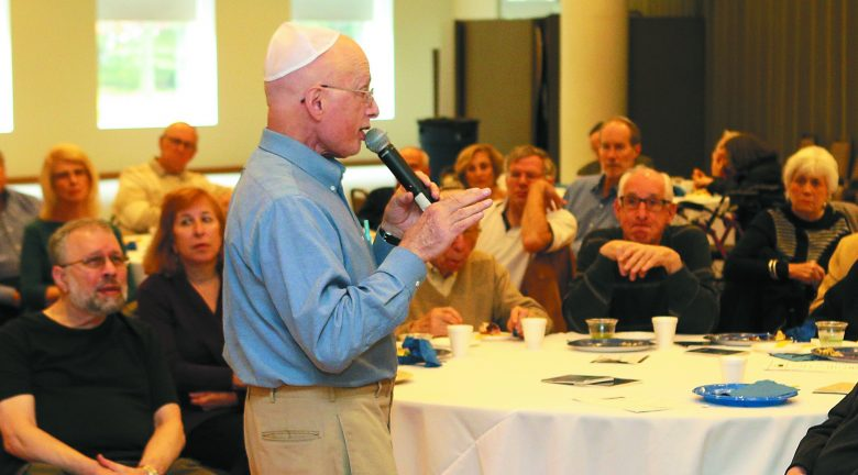 Dr. Itzhak Brook speaks at a Veterans Day brunch about his involvement in the Yom Kippur War.