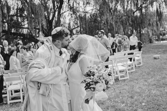 Meredith and Rabbi Yoni Dahlen seal it with a kiss.