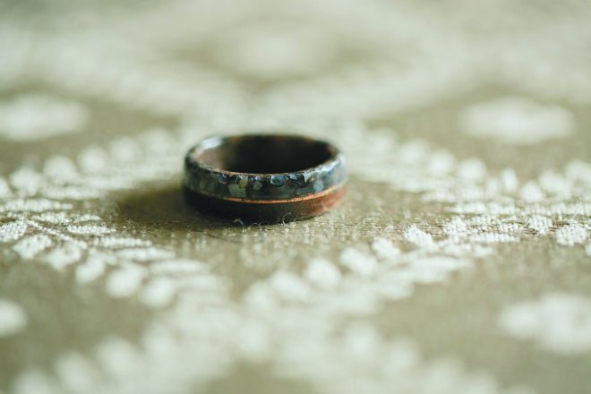 "Yoni's wooden engagement ring. ""After we got engaged,"" Meredith says, ""we thought it felt natural for Yoni to have a ring, too — it echoed the fact that we treat our relationship as a partnership rooted in equality."""