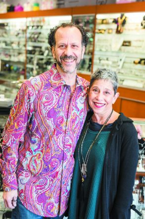 Siblings Rob Weinberger (left) and Terri Herman (right) stand together smiling at the camera.