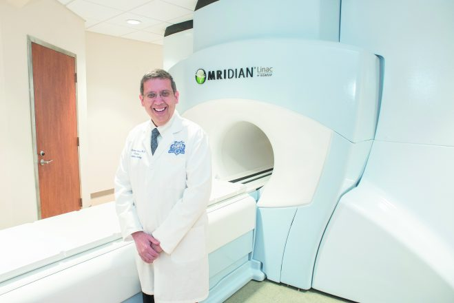 Dr. Benjamin Movsas in front of the ViewRay machine.