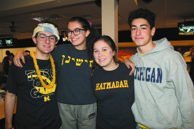 Brian Goldsmith, Eva Zaientz, Yakirah Mitchel and Mario Sims of Hatmadah BBYO hang out during the bowling competition.