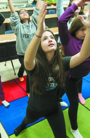 Jolie Oleshansky and other members of the Student Leadership Club participate in a Samaritans365 yoga program at school.