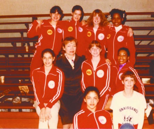 Coach Zina Mironov with her Detroit Metro Gymnastics team, including Wendy Hilliard (top row, far right)