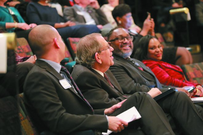 David Kurzmann, Rabbi Daniel Syme and Rev. Kenneth J. Flowers enjoy the program.