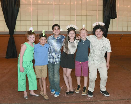 Sammy and other children from the show smile for the camera at Sammy's cooking-themed bar-mitzvah last June.