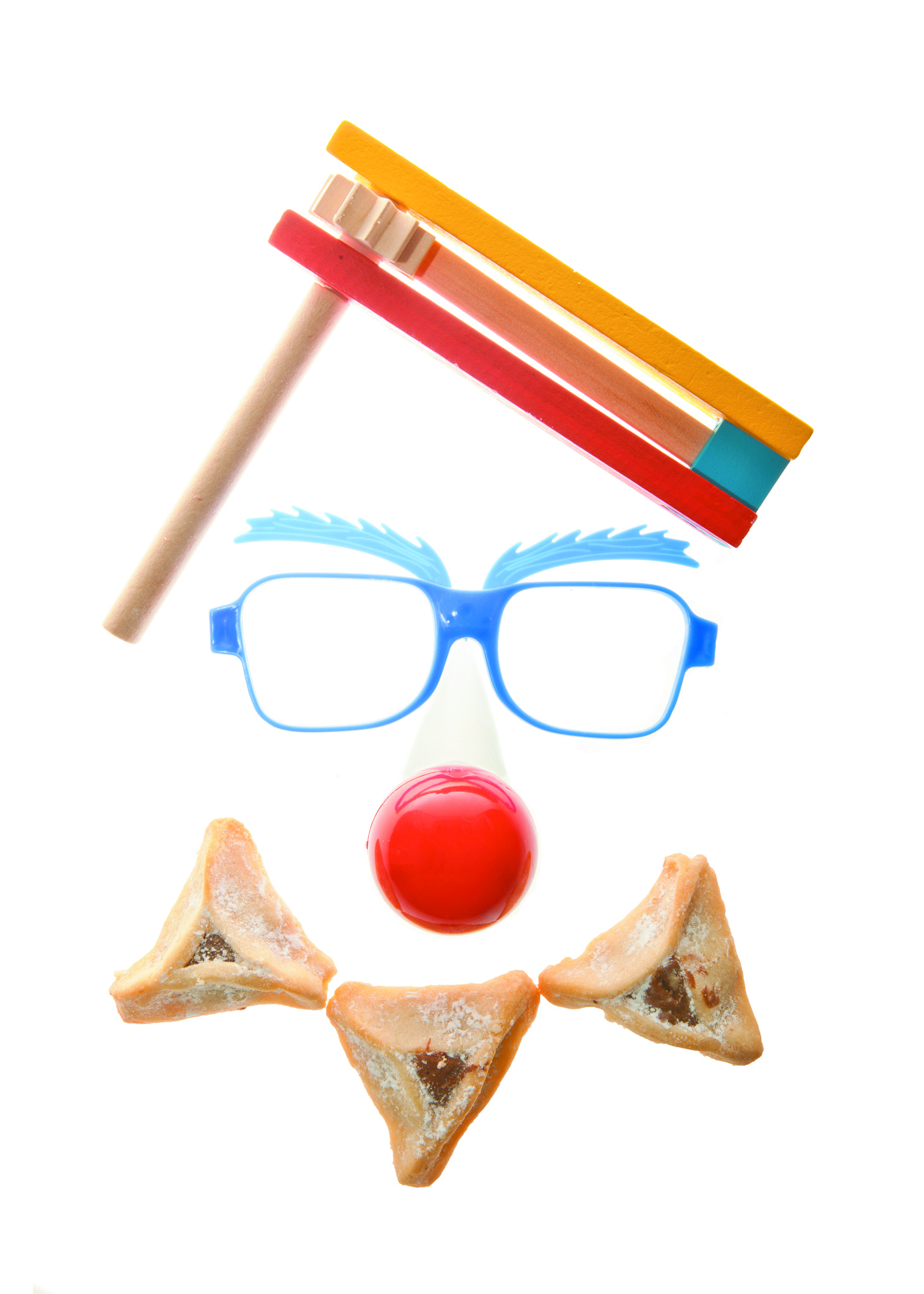 Clown's face - Purim arrangement with Hamentashen, Gragger, Funny glasses and a red nose