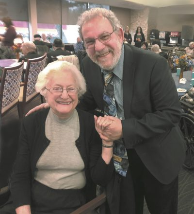 Dr. Charles Silow with survivor Edith Maniker.
