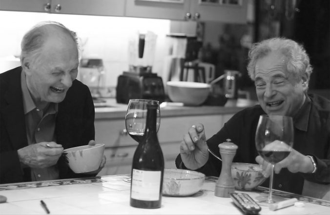 Itzhak having dinner (and a laugh) with Alan Alda