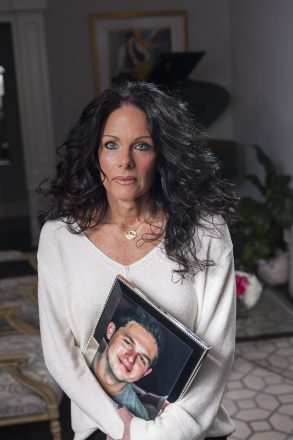 Lisa Daniels holds a photo of her son Jamie Daniels.