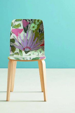 Charleston-based Lulie Wallace's painterly GARDEN TAMSIN CHAIR ($108) is perfect to pull up for cards and conversation. Anthropologie.com.