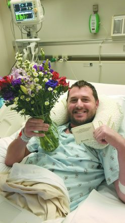 During one of many visits to the hospital, Brandon receives flowers to cheer his day.