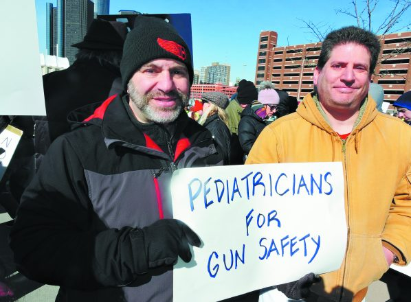 Pediatrician partners Robert Bloom of Beverly Hills and Udi Kapen of West Bloomfield marched locally because gun violence is a public healthcare issue.