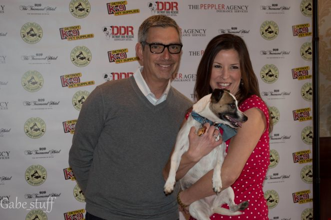 A man and a woman pose with a dog at Detroit Dog Rescue's Canines and Couture.