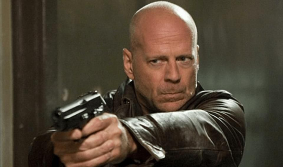 Still of Bruce Willis pointing a gun from the movie Death Wish.