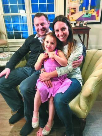 Brandon, healthy now, with his daughter, Nora, and wife, Emily.