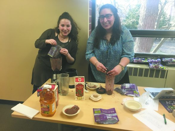 In January, U-M Hillel's environmental and sustainability group, Hayerukim, celebrated Tu b'Shevat with acai bowls. Noa Gafni, U-M Hillel's Jewish Agency for Israel Fellow, and Rebecca Grbinich, U-M Hillel's Social Justice Springboard Fellow, create theirs. ents learned about the holiday and discussed how to honor trees.