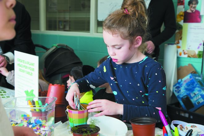 Aliza Ungar, 7, of Southfield planted dill to bring to her family seder.