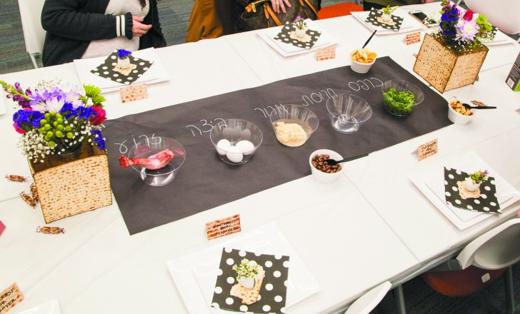 For the seder table, Pinterest suggests a linear seder plate using black craft paper with labels in Hebrew and a table set with snacks, egg shells as mini vases and sheets of matzah to frame vases of flowers.