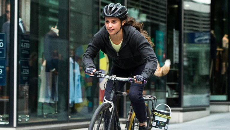 Still from Tomb Raider of Lara Croft (Alicia Vikander) on a bicycle.