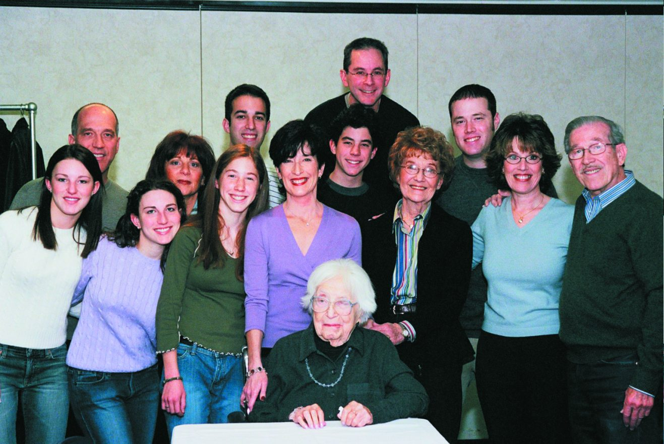In 2003, the family celebrated the 100th birthday of Fannie Whiteman, center, at Fleischman Residence. Fannie is the mother of Evelyn (Louis) Berlin, grandmother of Renee Krauss, Steven (Jill) Berlin and Joyce (Jeffrey) Weingarten, and great-grandmother to their children: Jonathan, Robert, Arielle, Aviva, Emily and Elliot. Now these great-grandchildren are all married; four of them have children.