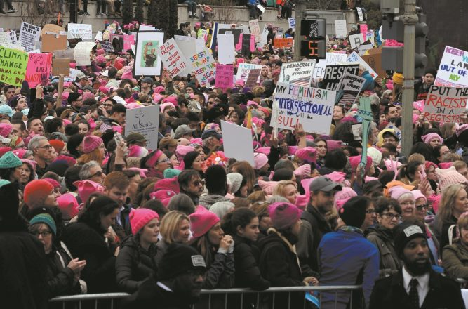 Protestors march in the Woman's March on Washington D.C. Jan. 21, 2017. The Capital Mall area was the starting point of the march, hundreds of thousands of people attended. (National Guard photo by Tech. Sgt. Daniel Gagnon, JTF-DC).