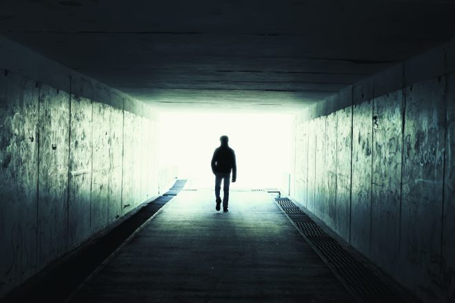 silhouette in a tunnel. Light at End of Tunnel
