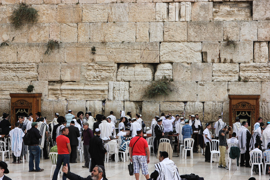 People praying at the Western Wall in the Old City of Jerusalem, Israel.